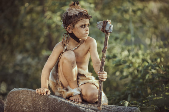 caveman manly boy with primitive weapon hunting ou RZLKNSE